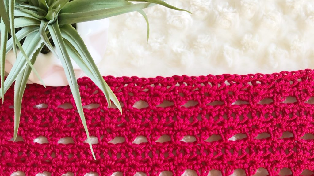 Red crochet panel with open stitch detail